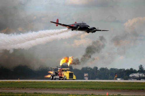 The Shockwave Jet Truck, a heavily modified semi capable of speeds over 300 mph, prepares to race a Beech 18 piloted by Matt Younkin.