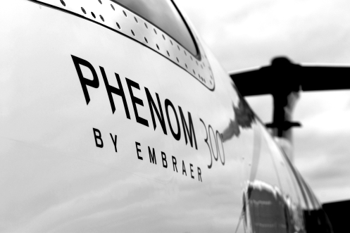 The nose of an Embraer Phenom 300, seen in this black-and-white capture. Over 100 have been built since the Phenom 300 was introduced in 2009.