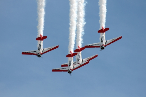 The AeroShell Aerobatic Team, seen during a performance at AirVenture. The team, which flies four North American AT-6 Texans, has been a fixture on the airshow circuit for over 25 years.
