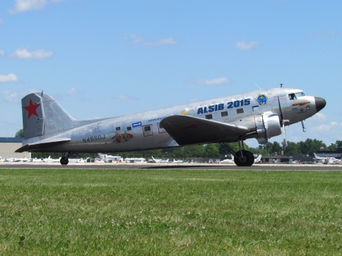 N4550J departing Oshkosh, Wisconsin, on July 21, 2015. Here she wears full ALSIB 2015 titles.